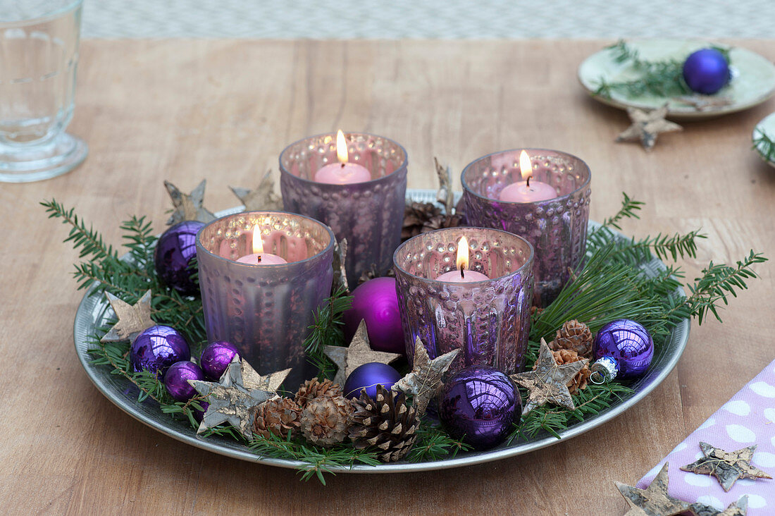 Fast Advent wreath of silver lanterns on a wide bowl