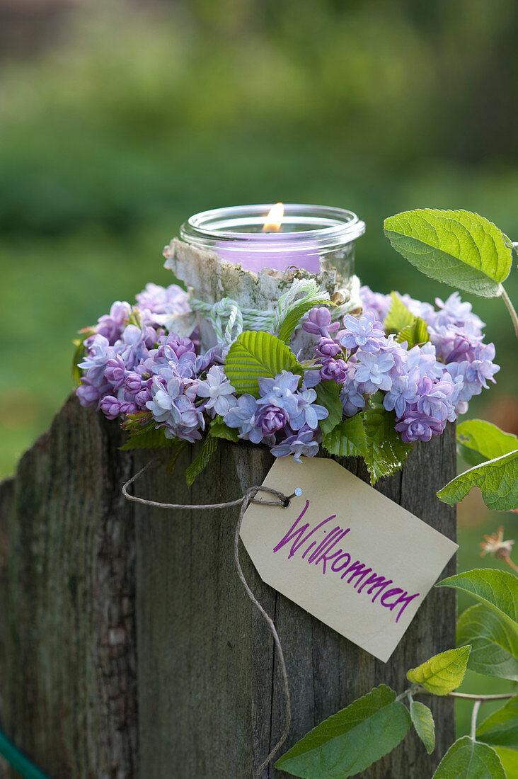 Preserving jar as a lantern with Betula bark, in Syringa wreath