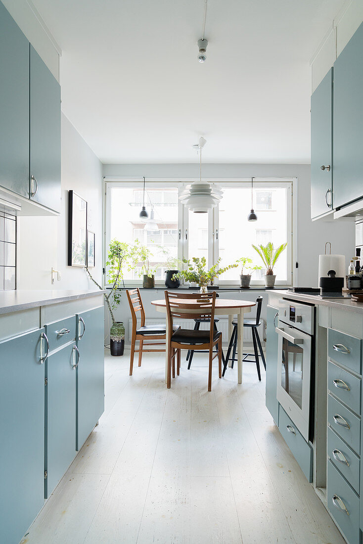 Pale Blue Cupboards And Dining Table Buy Image 12374496 Living4media