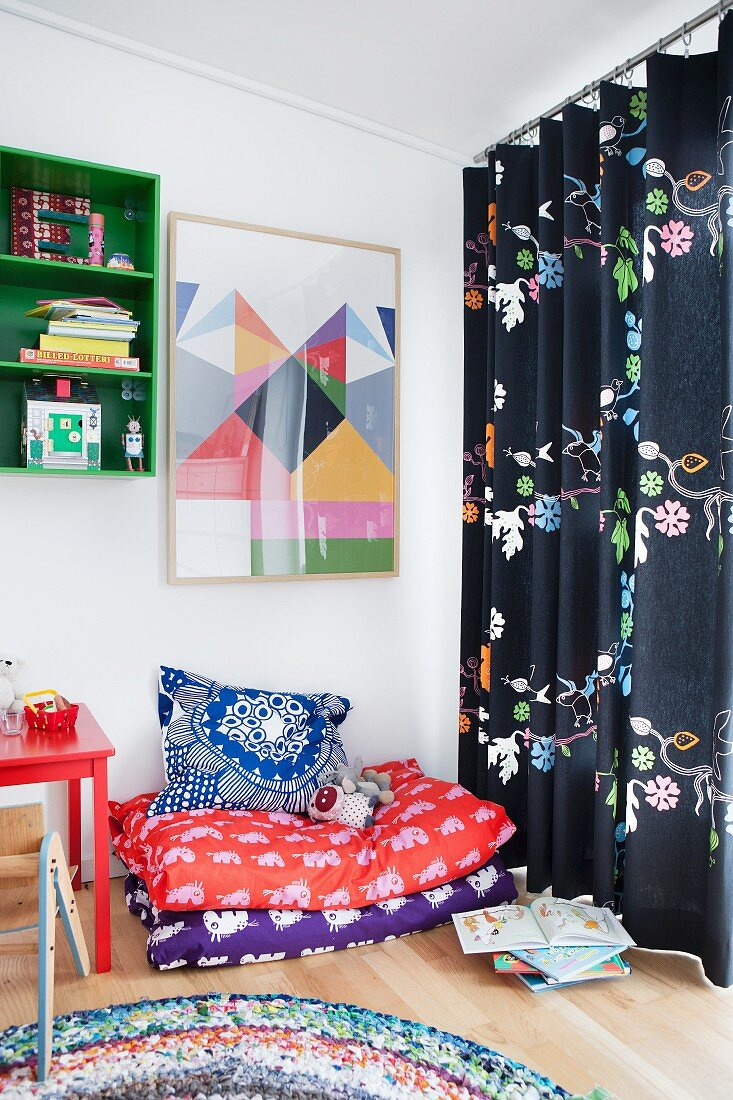 Blankets and cushions in cosy corner of child's bedroom