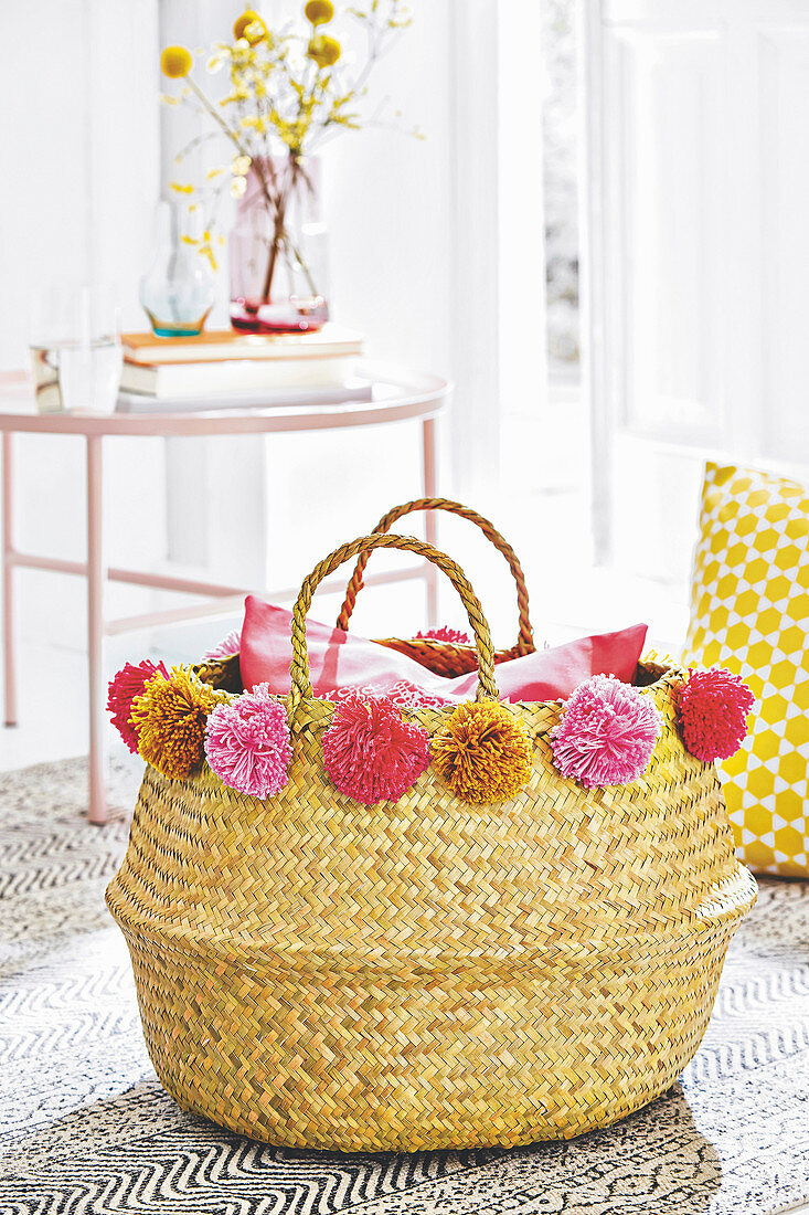A basket decorated with homemade pompoms