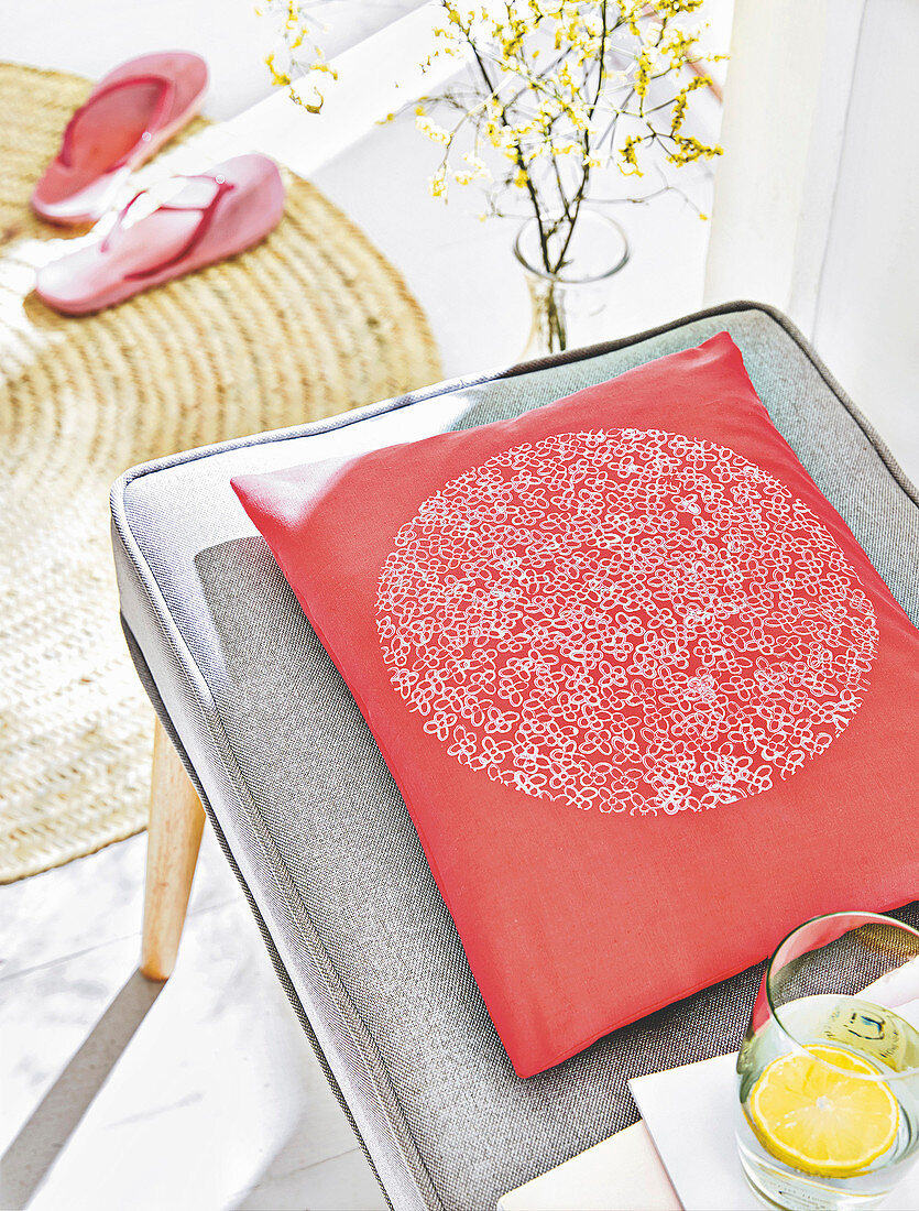 A homemade cushion cover with a stamped pattern