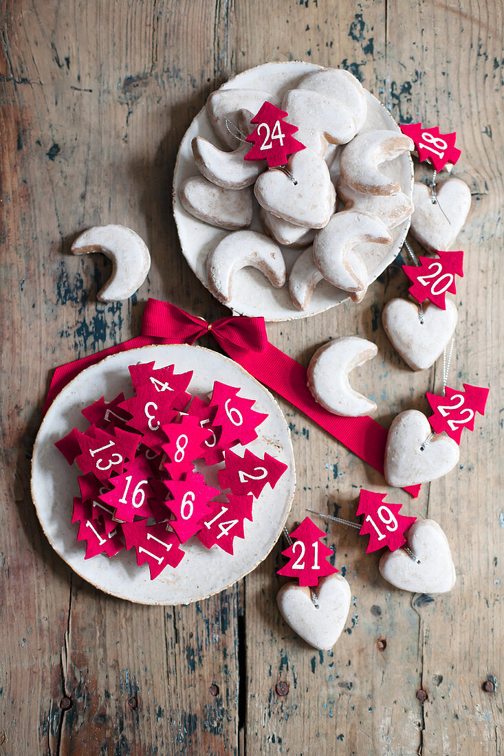 Iced biscuits and small, numbered, felt trees