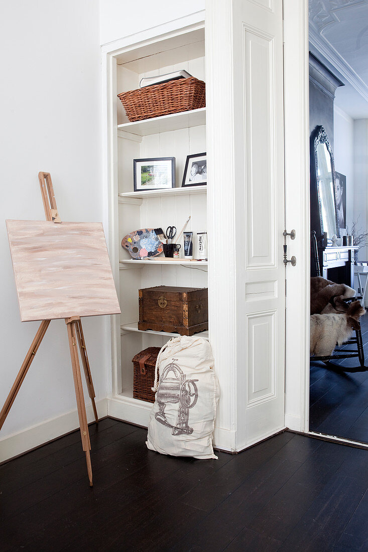 Easel in front of a built-in shelf