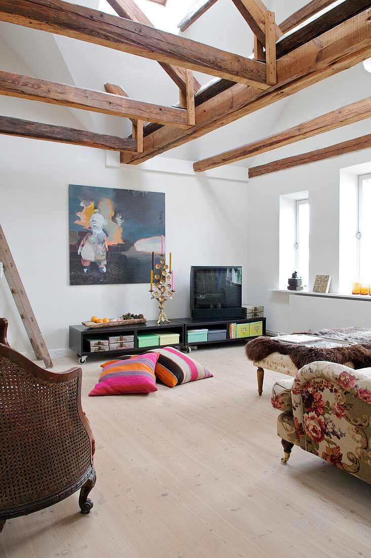 Cathedral ceiling living room with wooden beams