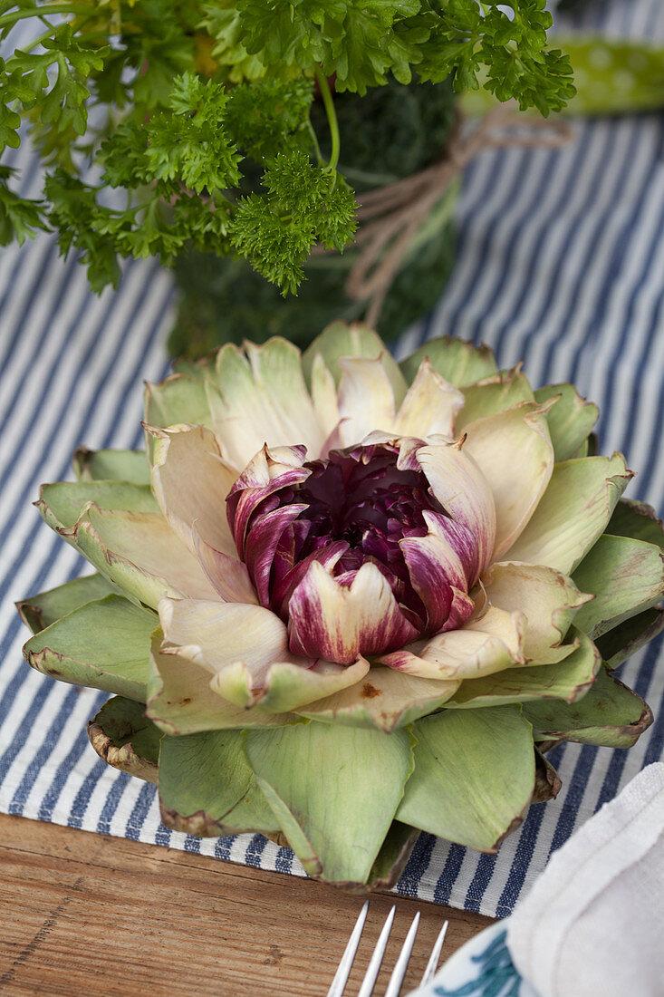 Open artichoke flower decorating table