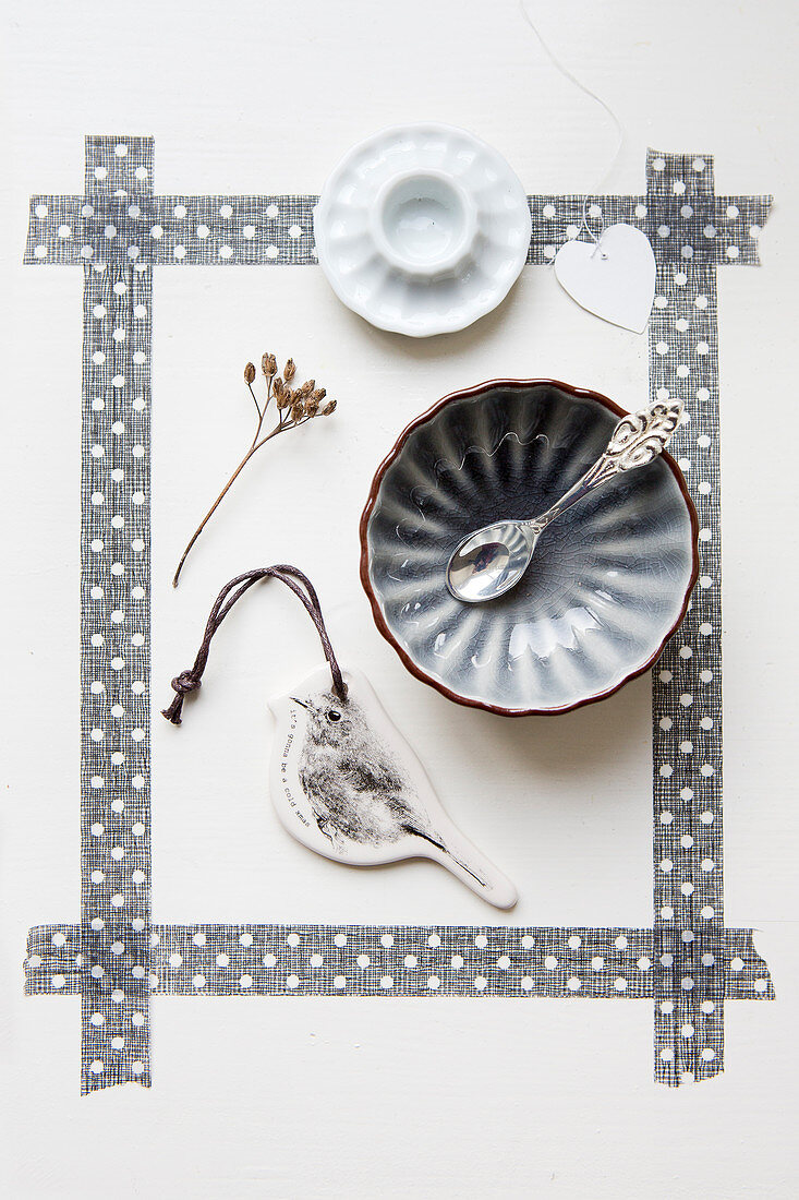 Bowl, bird pendant, and egg cup in a frame made of gray washi tape