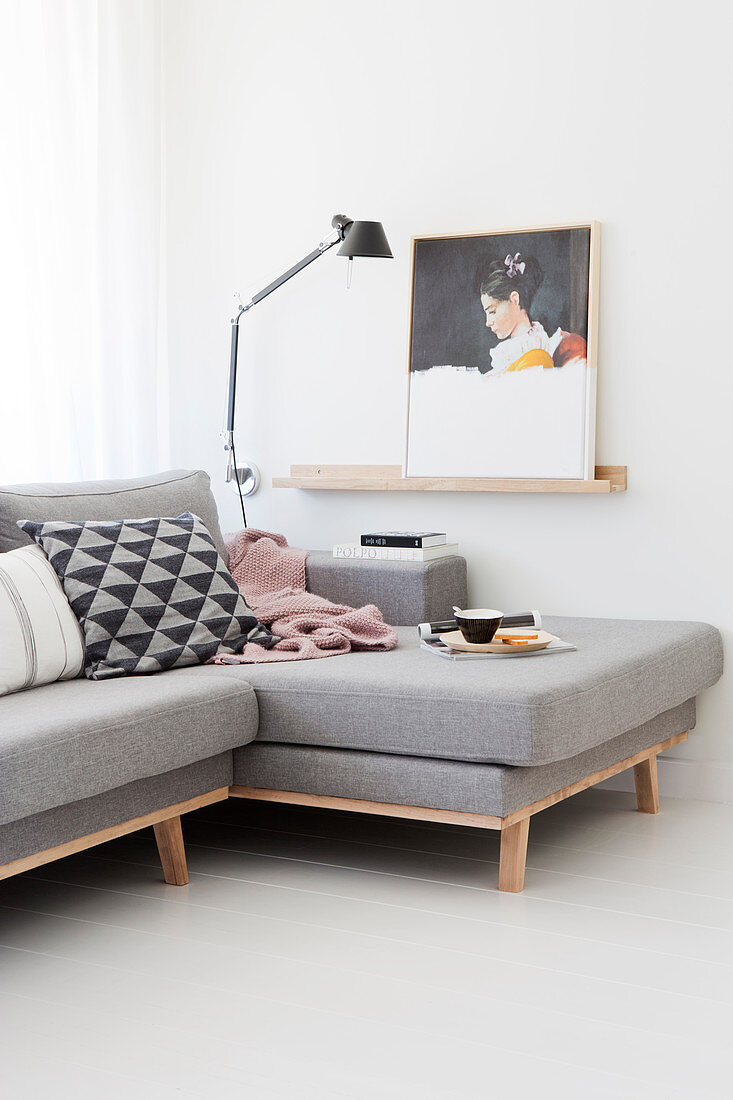 Pale grey chaise sofa in white living room