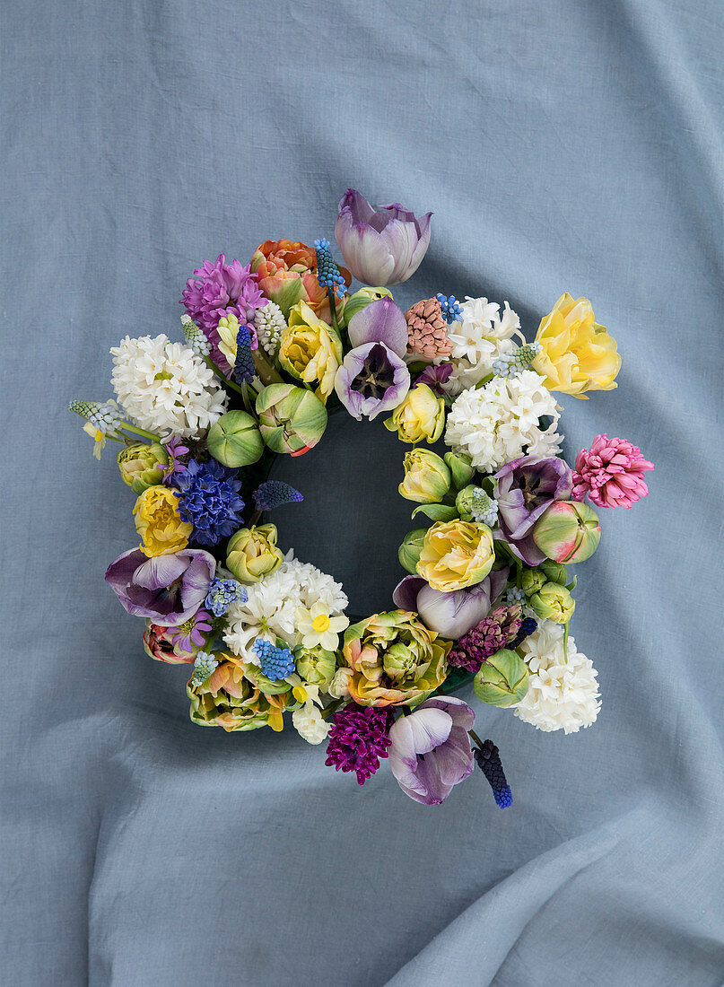 Lush colorful floral wreath with various spring flowers