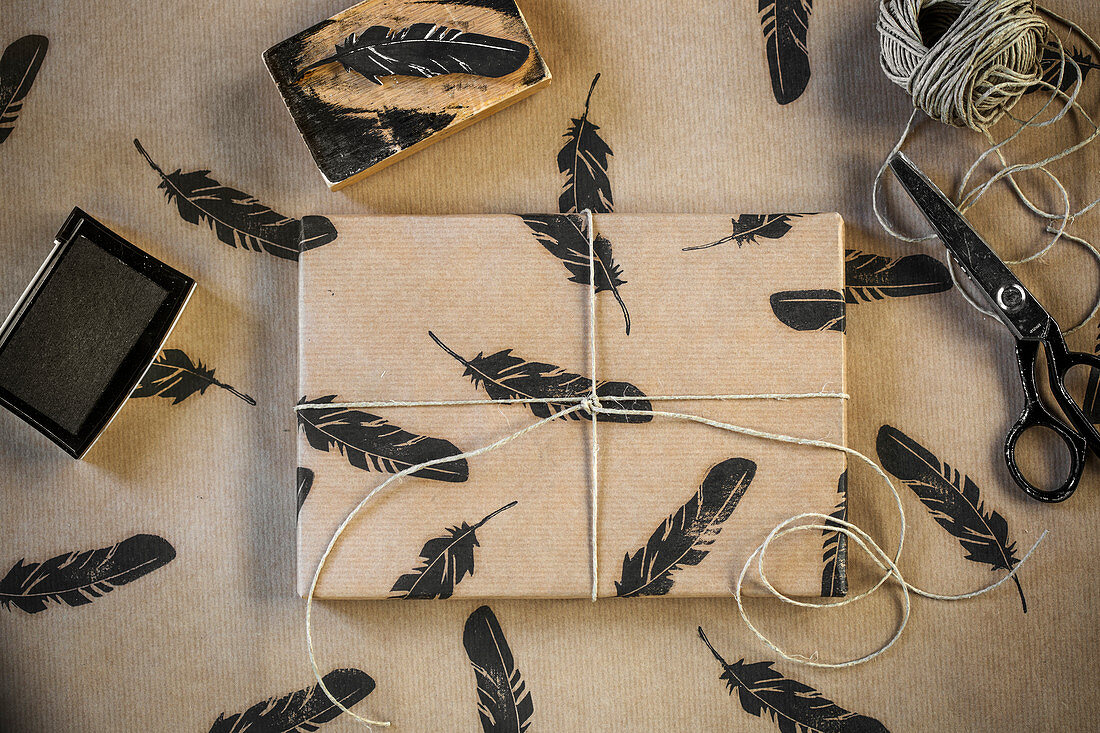 Wrapping paper with a decorative feather print