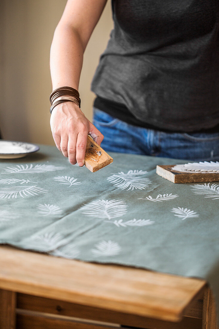 Stamping the fabric with a leaf motif