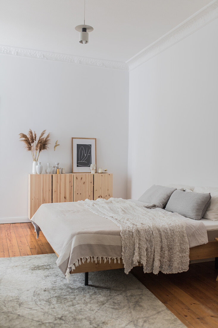 Minimalist bedroom in natural shades