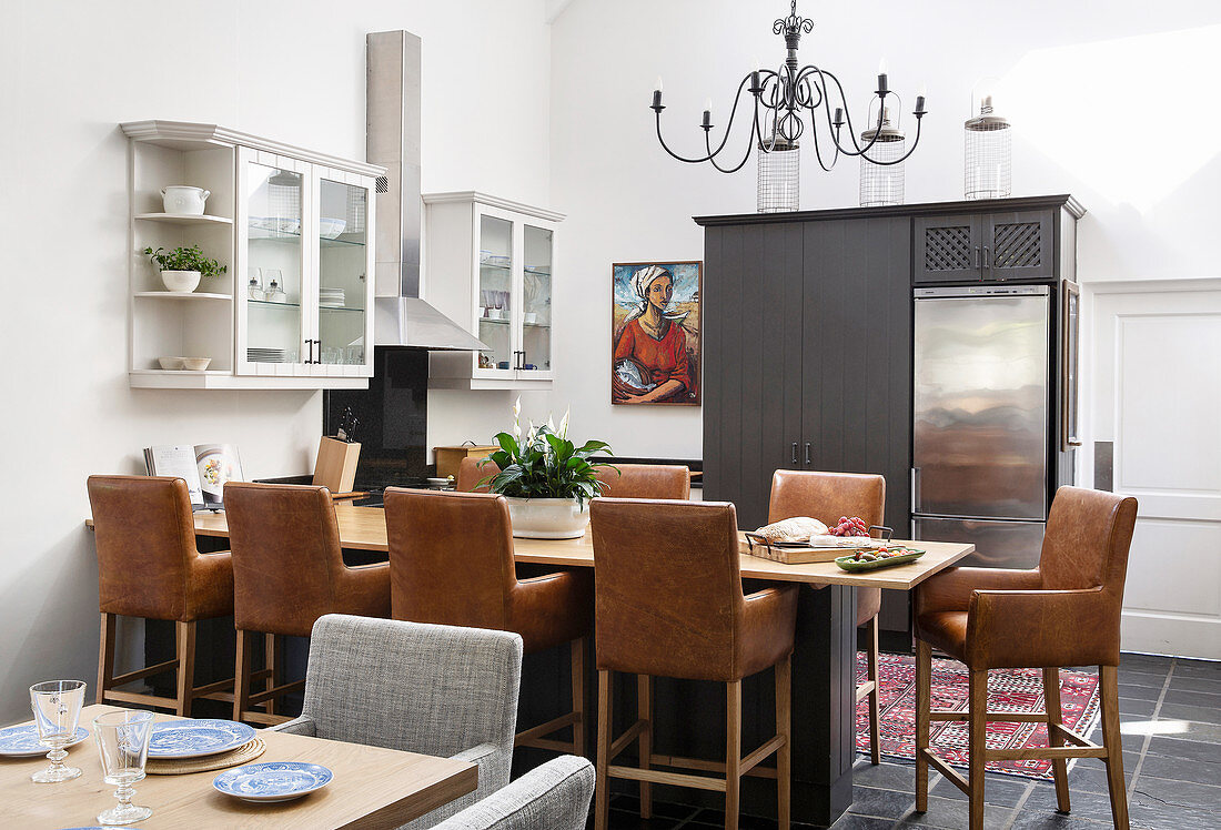 Dining table, leather chairs and black … – Buy image – 9 ...