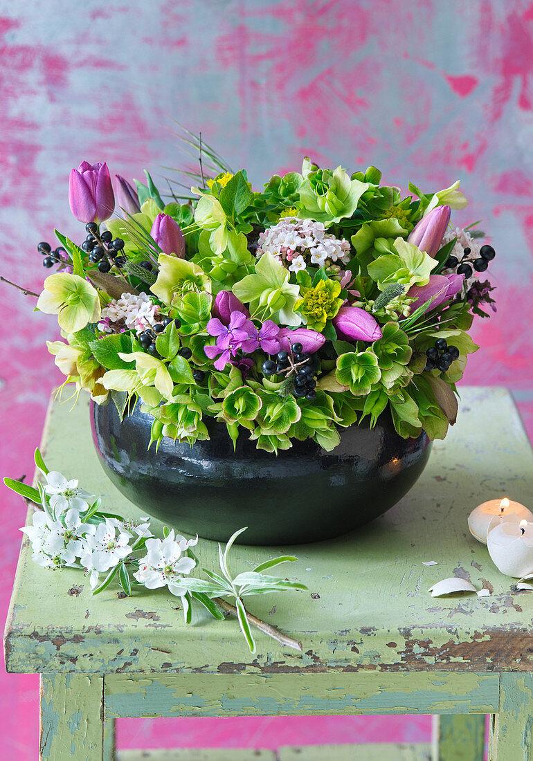 Hellebores, tulips, Viburnum tinus, honesty and thoroughwax