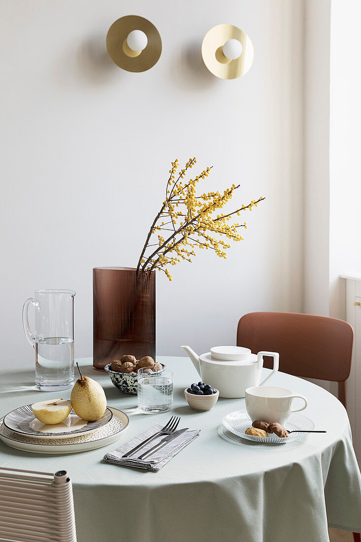 Simply set breakfast table in natural shades