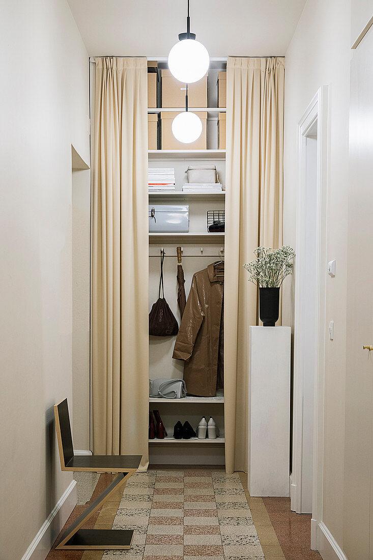 Floor-to-ceiling wardrobe behind beige curtains in hallway