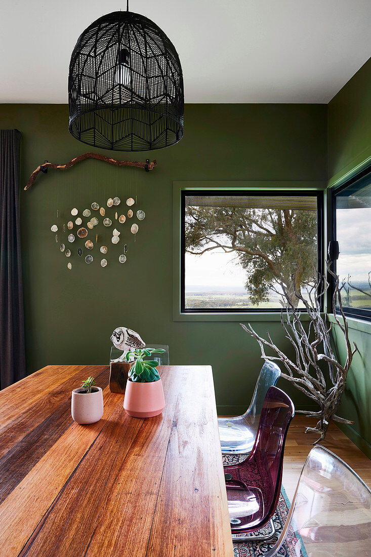 Dining room with green walls and corner windows