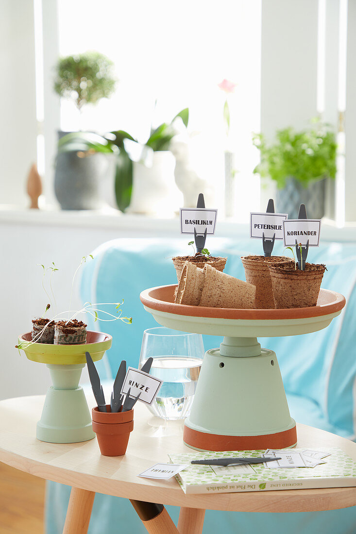DIY plant stands made from painted terracotta pots