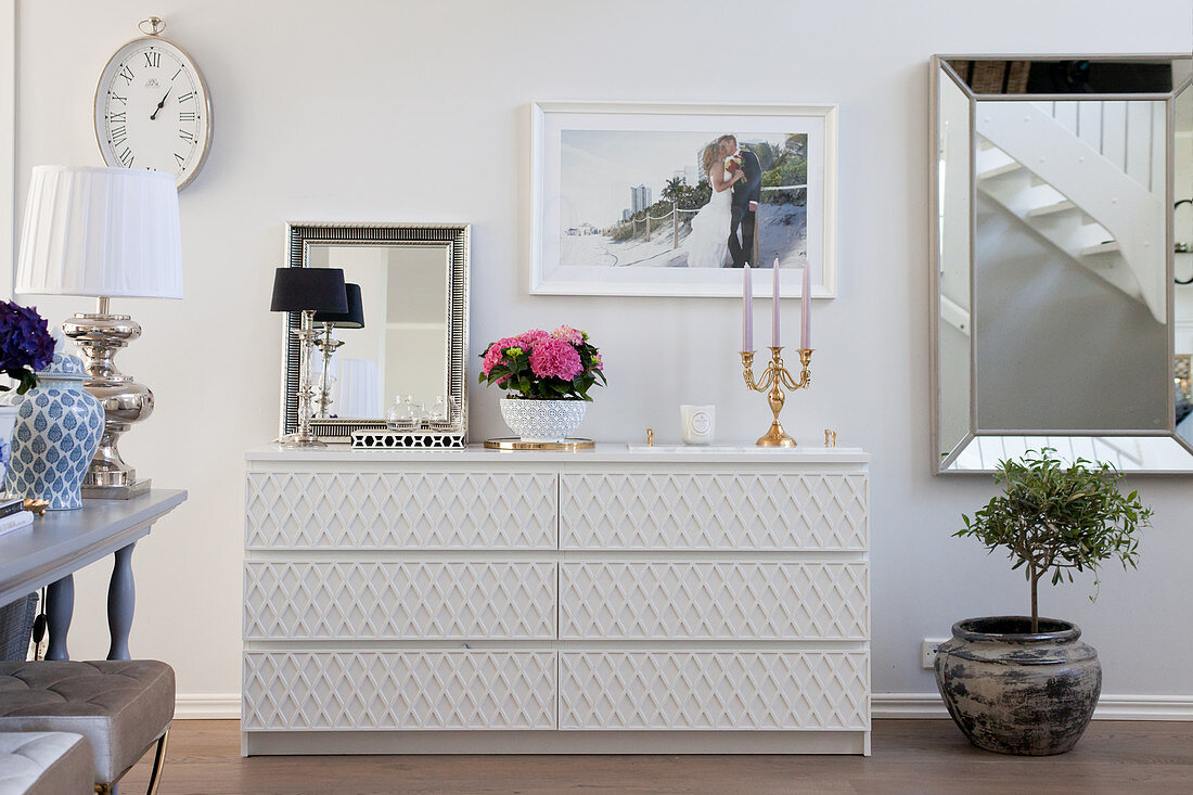 Chest of drawers with structured fronts in elegant living room