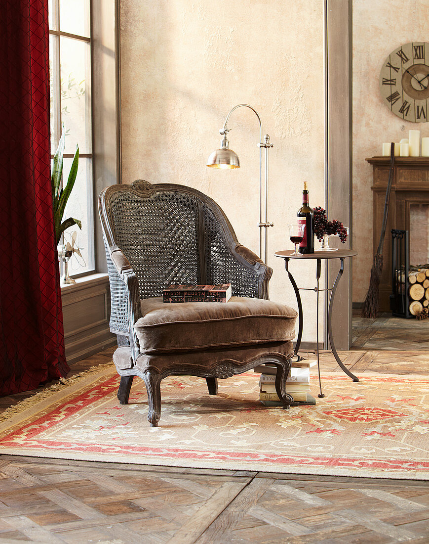 Vintage-style armchair with Viennese cane backrest in living room