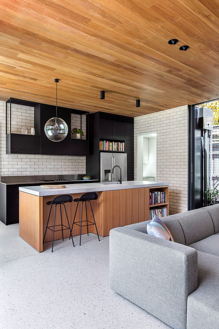 Modern open living room with wooden ceiling and kitchen island