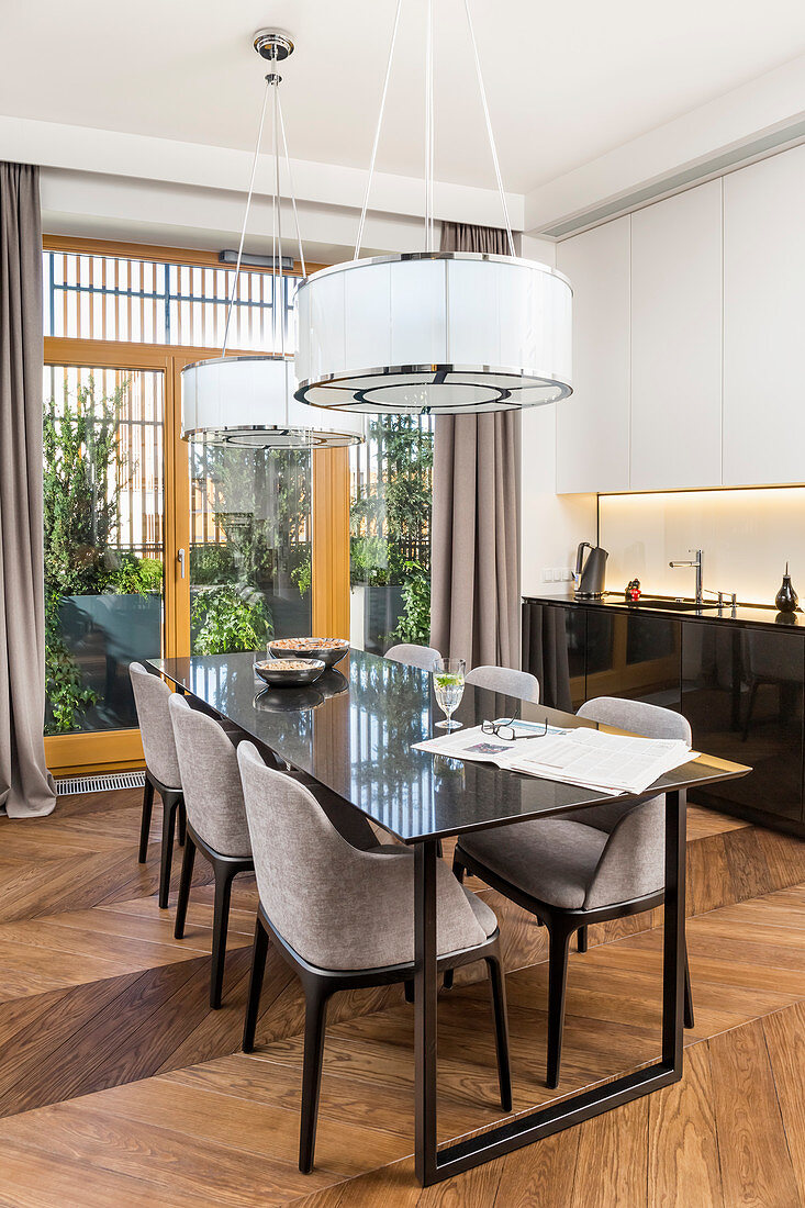 Elegant dining table with upholstered shell chairs