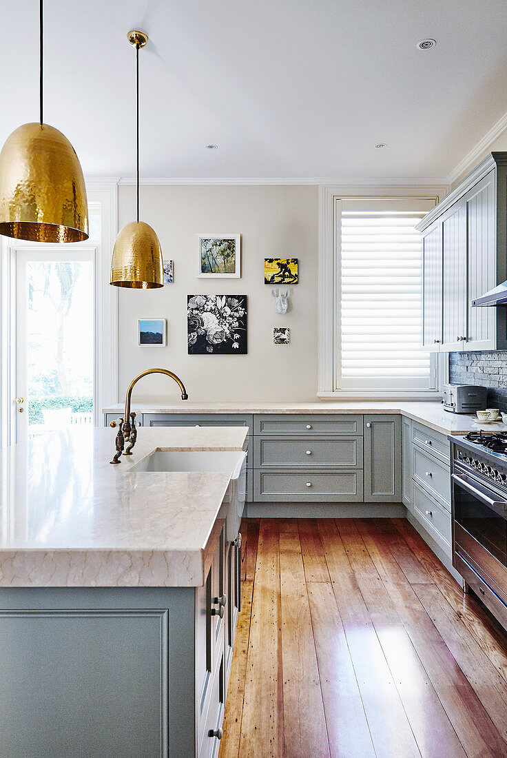 Country-house kitchen with pale blue cupboards and island counter