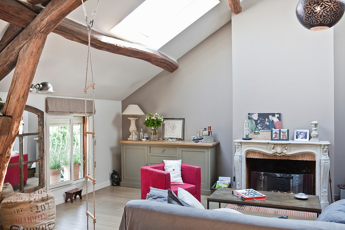 Open fireplace in attic living room