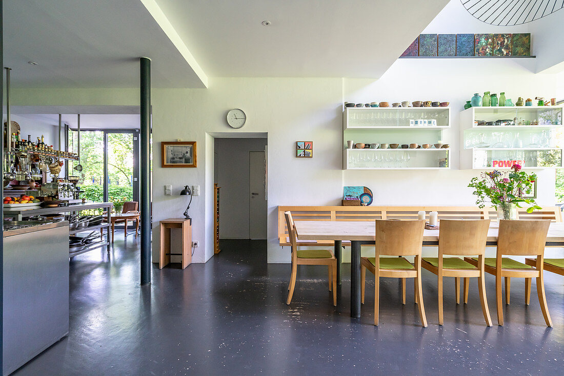 Dining area in high-ceilinged, open-plan interior