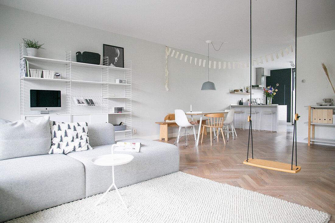 Swing in modern, Scandinavian-style, open-plan interior