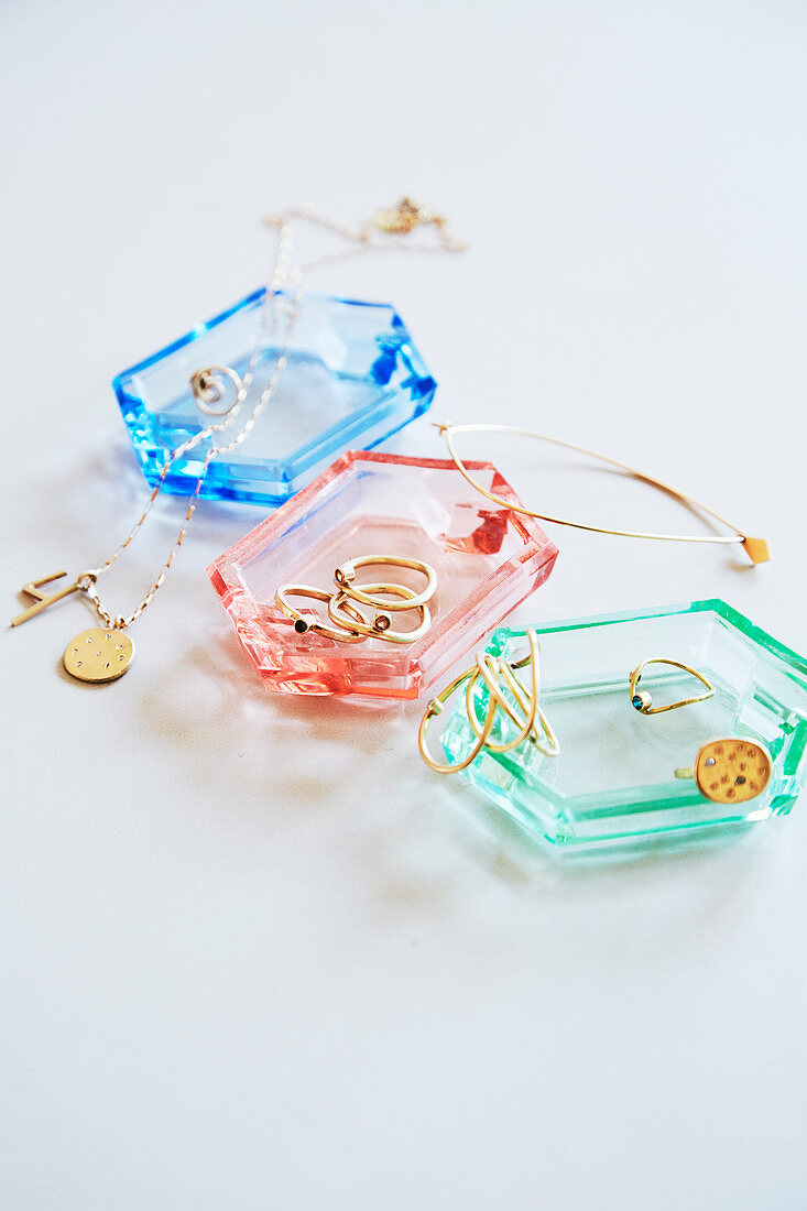 Coloured glass dishes used to store jewellery