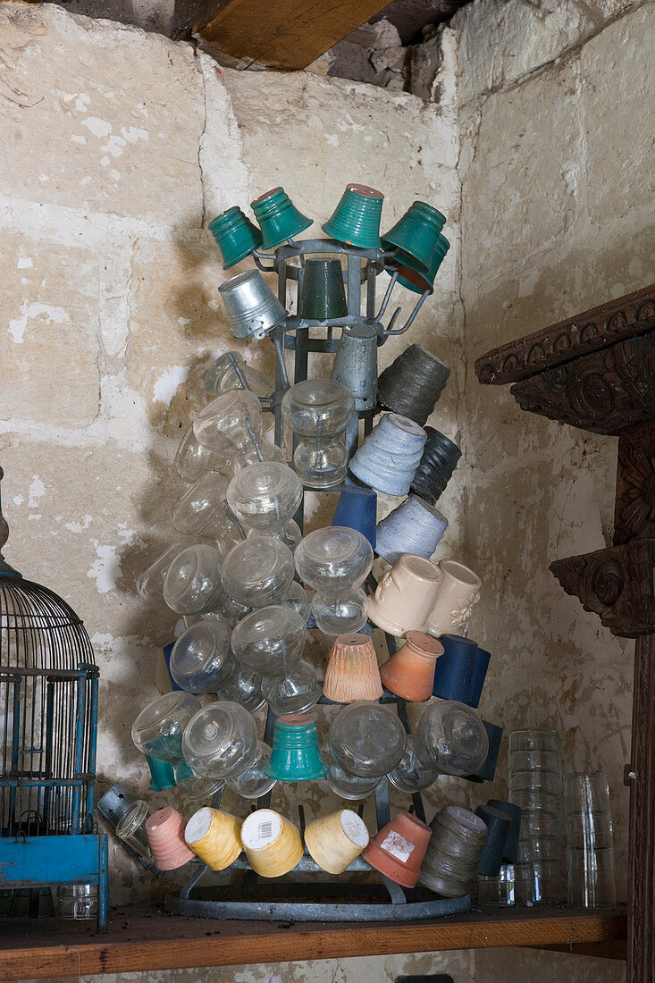 Plant pots and vases on vintage metal bottle drying tree
