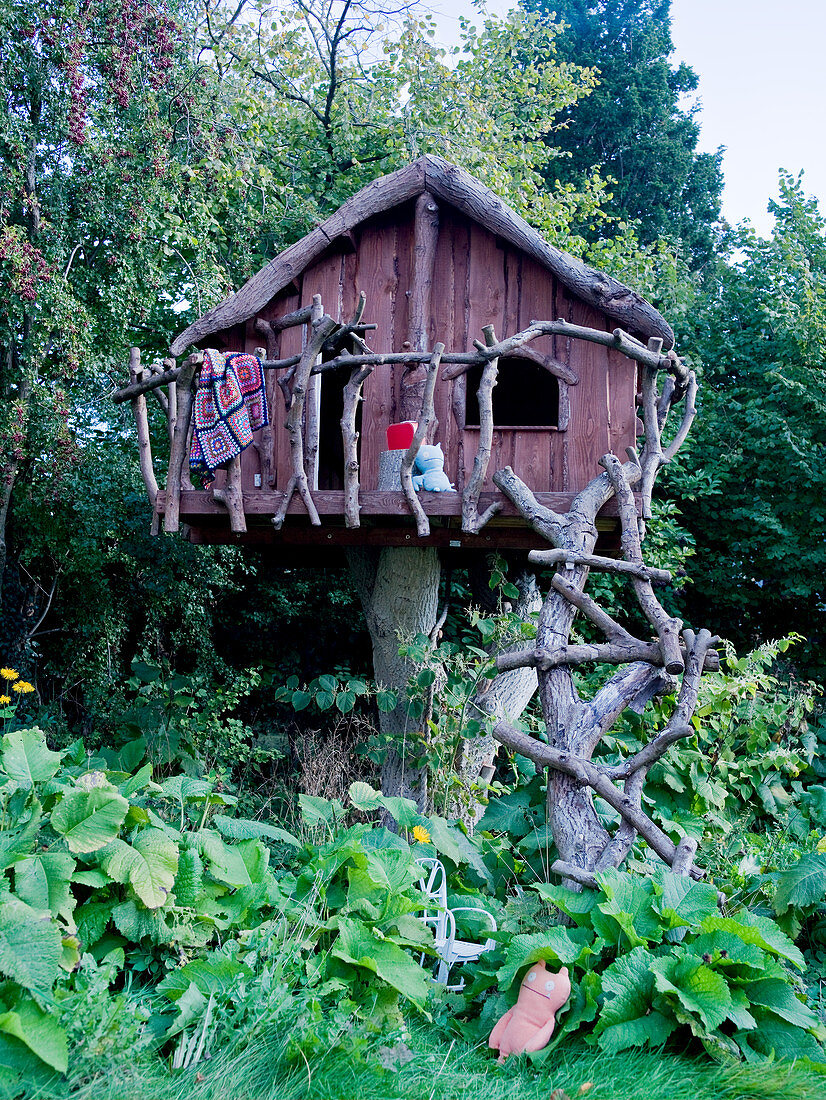 Rustic tree house on tree stump
