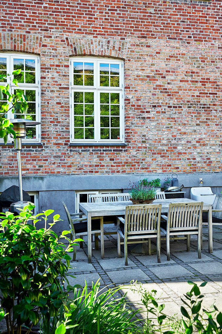 Seating area on paved terrace adjoining house