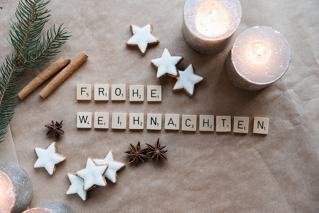 Christmas greeting made from Scrabble tiles, cinnamon stars and star anise