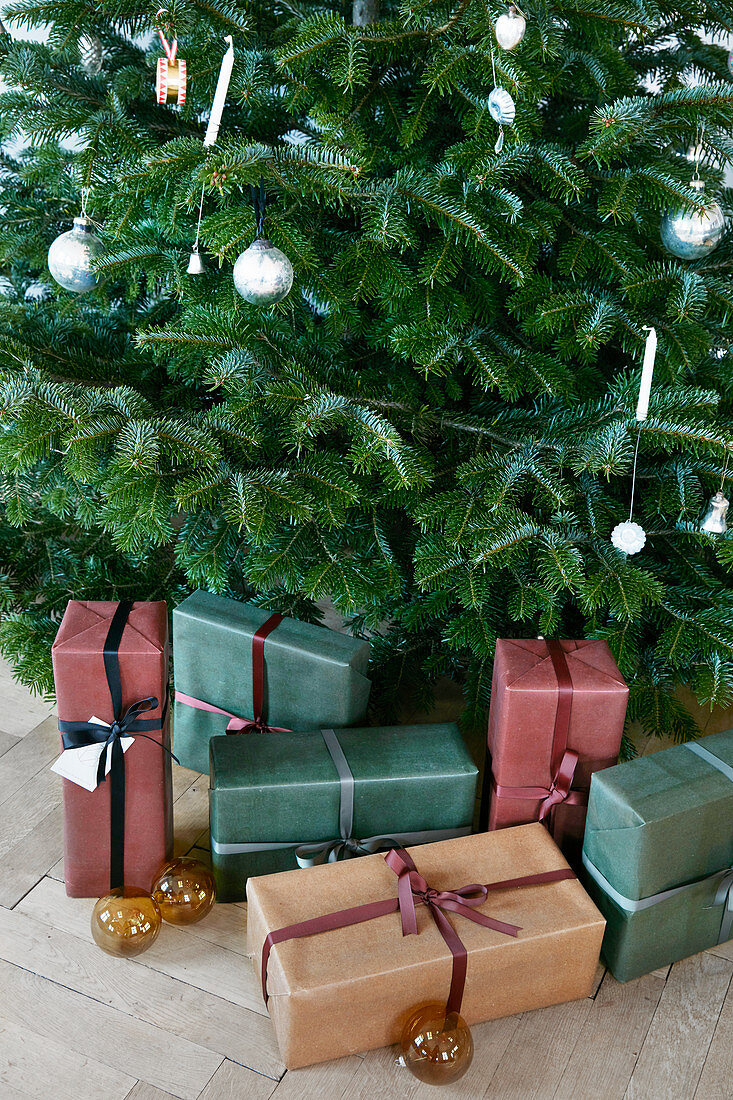 Wrapped presents under decorated Christmas tree