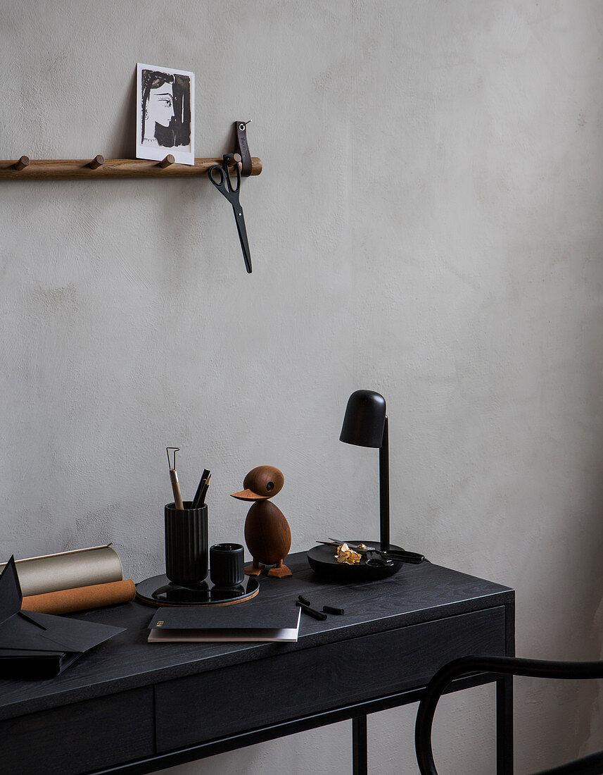 Black desk with masculine vintage accessories