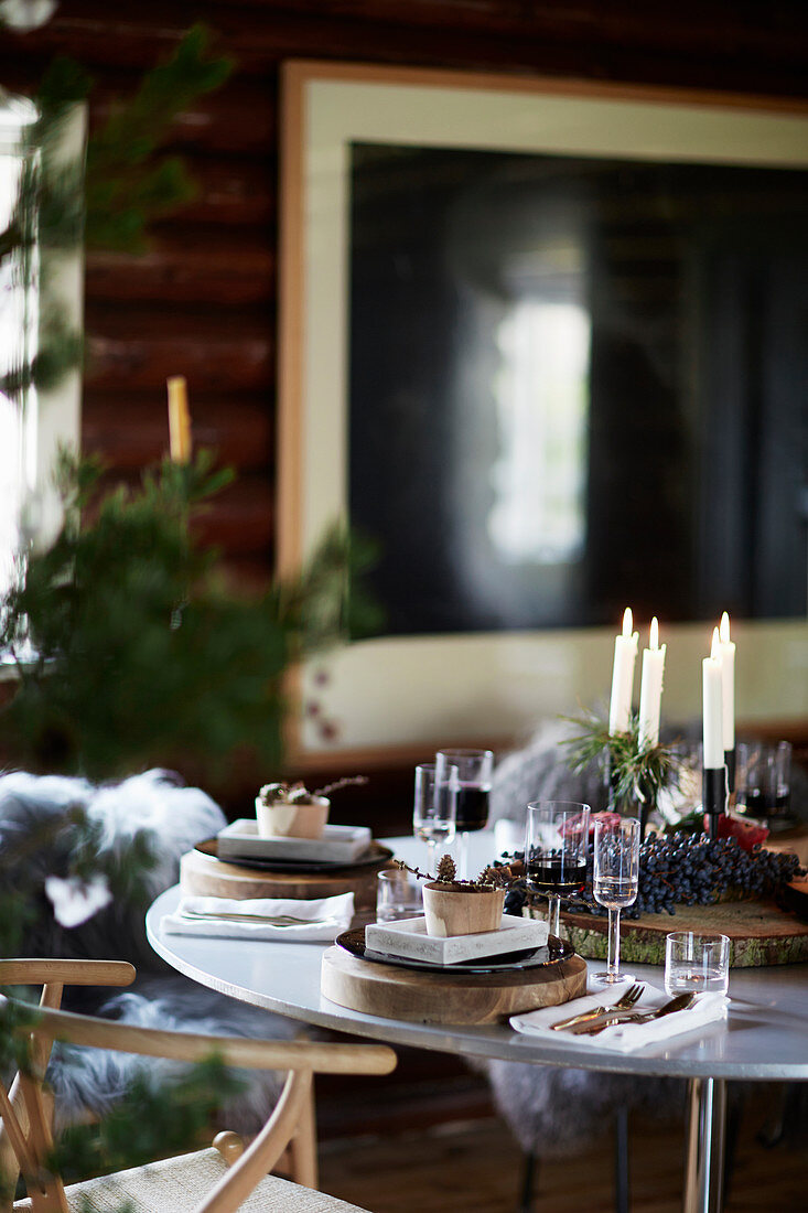 Candles on table festively set for Christmas