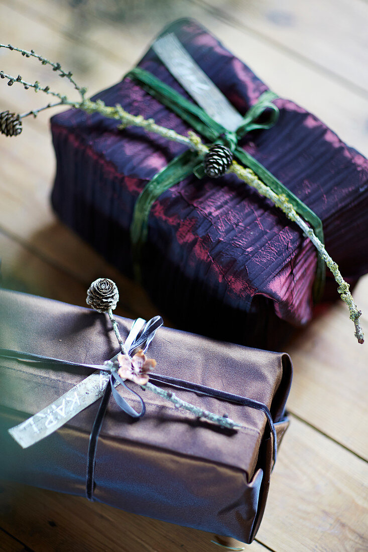 Christmas presents wrapped in paper in shades of purple