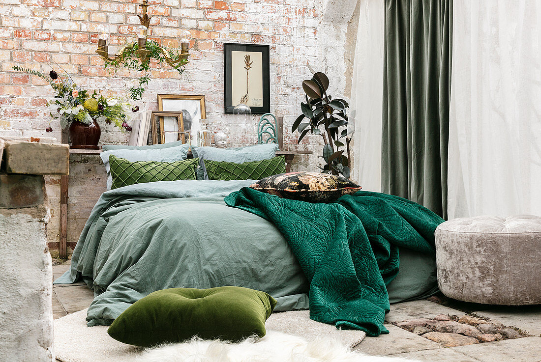 Vintage-style bedroom with brick wall and green accents