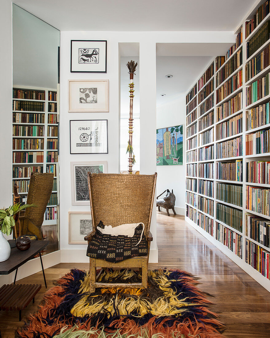 Easy chair on retro long-pile rug next to bookcase