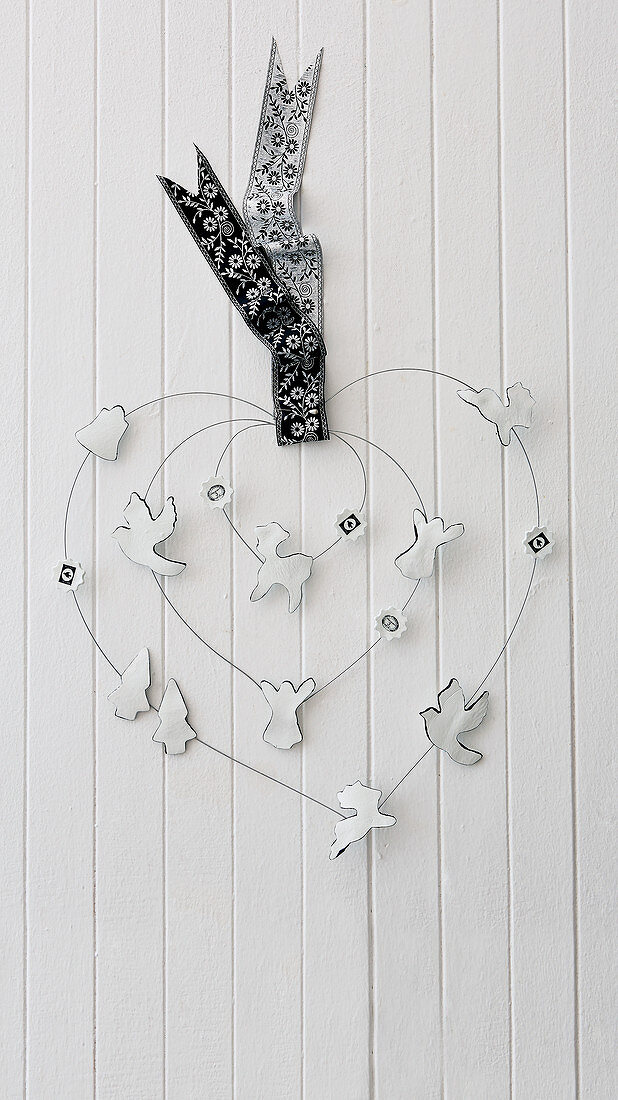 DIY wire heart decorated with festive air-dried clay figurines