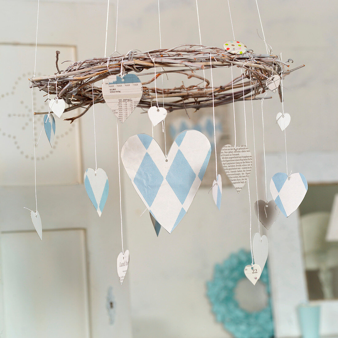 Mobile of paper hearts hanging from vine wreath