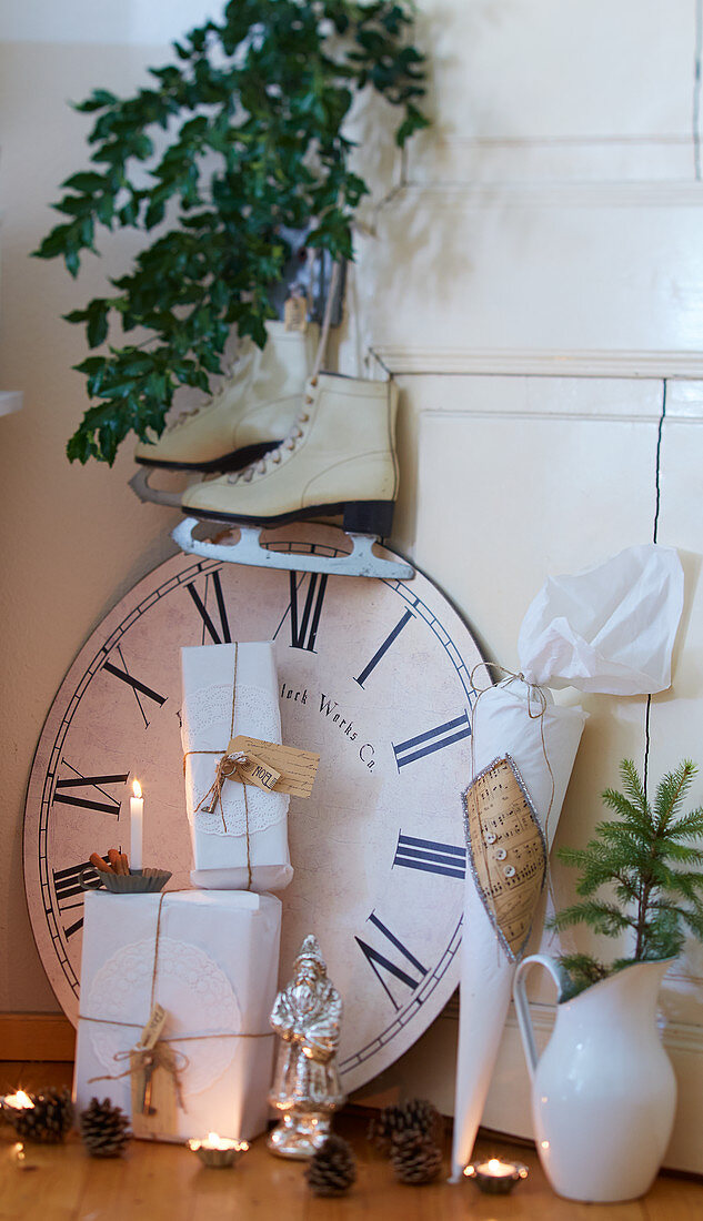 Wrapped gifts, clock face and vintage-style accessories