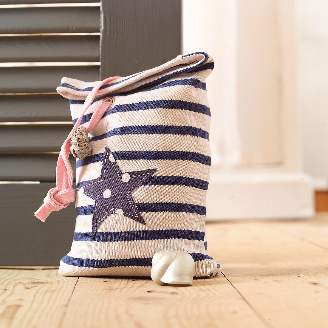 Door stop made from sleeve of striped shirt