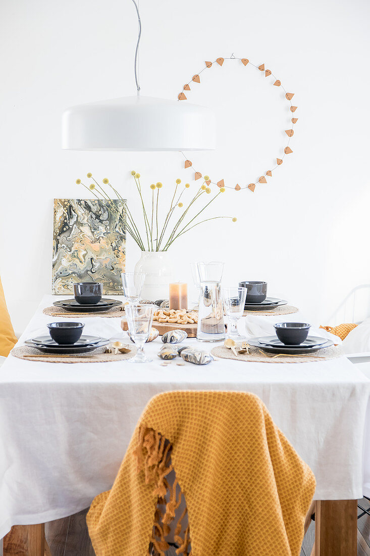 Table set in natural colours with handmade decorations