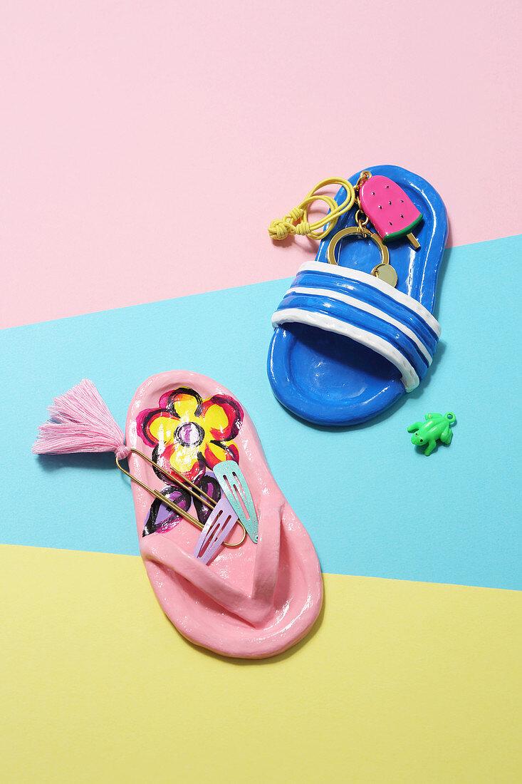 Handmade, modelling compound keyring pendants and dishes shaped like flipflops