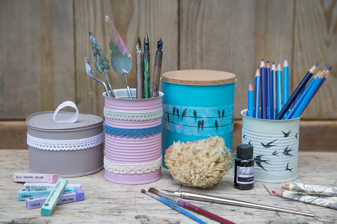 Handmade organisers made from painted and decorated tin cans