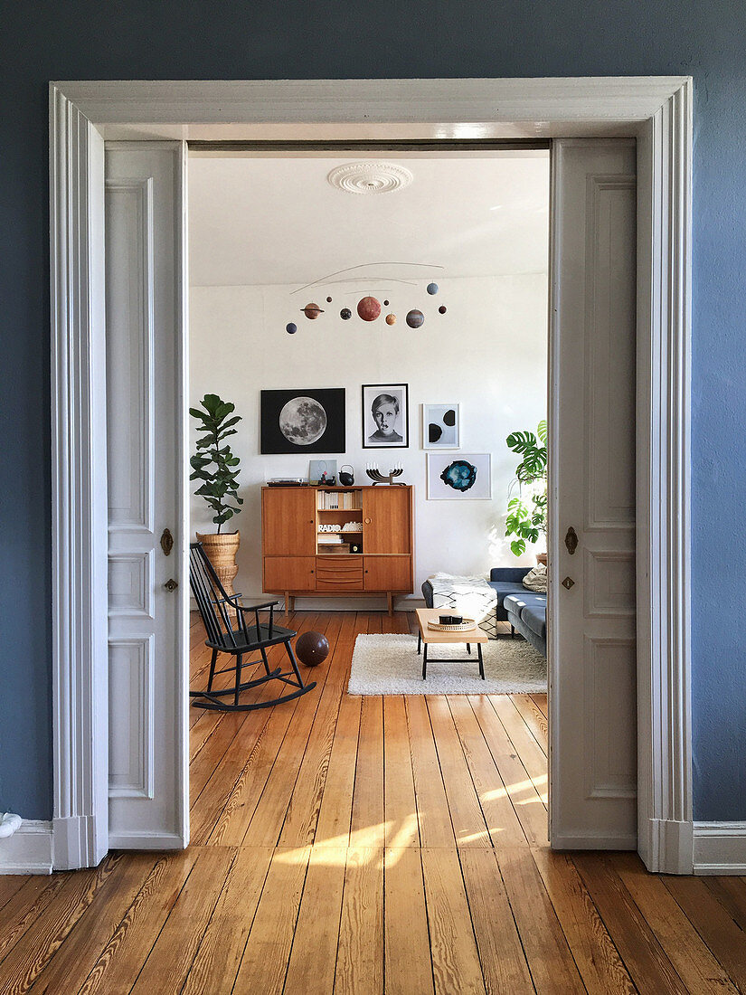 View through open sliding doors into vintage-style living room