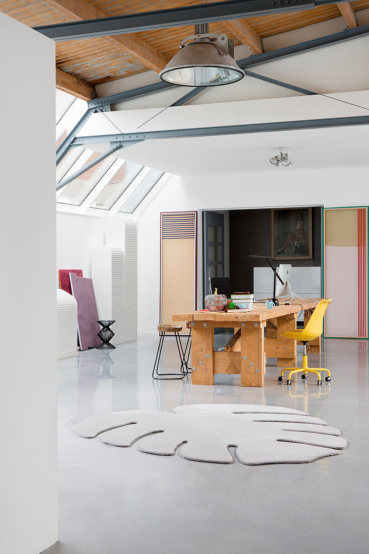 Rug in shape of Swiss cheese plant leaf in loft-style studio